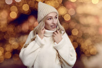 Beautiful young woman in winter sweater and hat