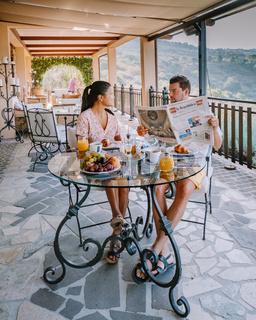 couple having breakfast at luxury villa at the Italian country side near Rome Italy