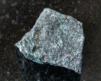 ough Magnetite ore on black