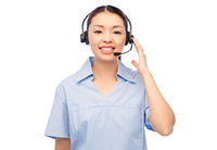 smiling asian female doctor or nurse in headset