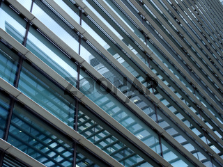 a full frame modern office architecture abstract with geometric shapes and buildings reflected in blue glass windows
