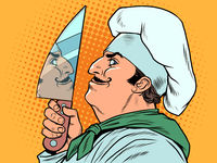 A male cook with a kitchen knife