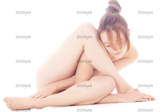 Naked gymnastic model folding herself up