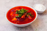 Delicious red borsch with herbs and sour cream