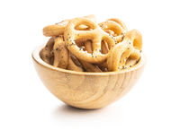 Crispy salted pretzels in wooden bowl