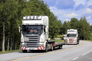 Fleet of Three Semi Trucks on Road