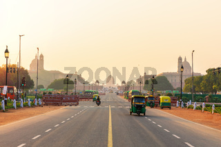 Sunset traffic in New Delhi, tuc tuc cars on the road to the Presidential Residance