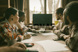 Teamwork Of Young Freelancers In Sunny Coworking Space