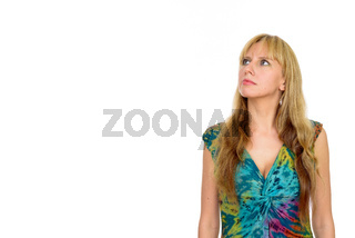Portrait of beautiful blonde woman thinking and looking up