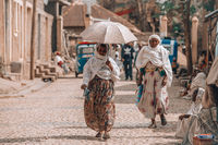 Women return from the morning Mass, Aksum Ethiopia, Africa