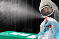 Disinfection workers check whether spraying equipment on various surfaces is working.