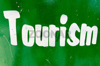 Tourism text printed in white against green background