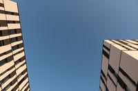 Minimalist building with clear blue autumn sky