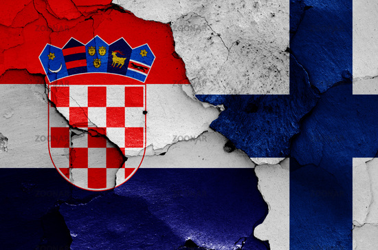 flags of Croatia and Finland painted on cracked wall