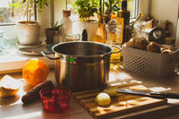 Still life kitchen with large pan and groceries