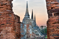 Brick ruins and white stupas of ancient buddhist temple in Ayutthaya