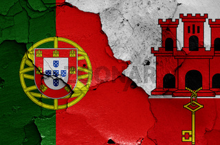 flags of Portugal and Gibraltar painted on cracked wall