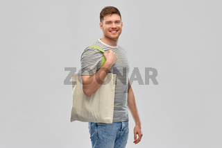 man with reusable canvas bag for food shopping