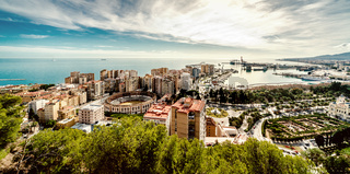 Picturesque view of Malaga bullring (La Malagueta) and seaport. Spain
