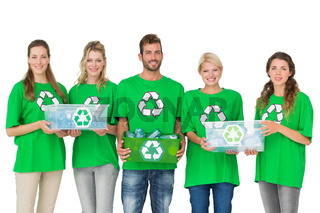 People in recycling symbol t-shirts carrying boxes