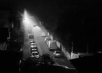 Empty street by a foggy night in Bayonne, France