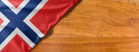 National flag of Norway on a wooden background with copy space