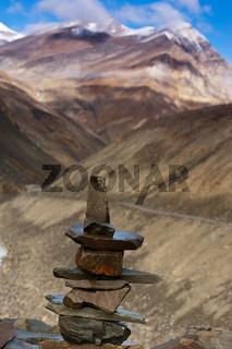 Buddhist stone pyramid at Suraj Vishal Taal Lake at Manali - Leh highway. Himalaya mountains landscape. India, Ladakh, Lahoul Valley, altitude 4883 m