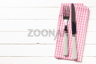 fork and knife on checkered napkin