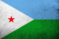 the Republic of Djibouti National flag. Grunge background