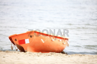 Lifeguard beach rescue equipment orange boat