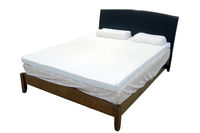 Modern double bed with cotton sheets and clipping path