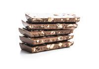 Milk chocolate bar. Pile of nut chocolate