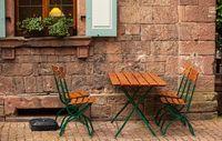 Photo of an empty street cafe in Germany. Lockdown in Europe.
