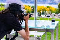 photographer takes photo of wine glasses