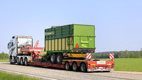 Truck Hauls Forage Wagon on Road