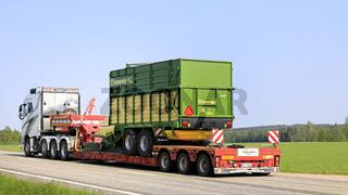 Truck Hauls Forage Wagon on Road