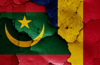 flags of Mauritania and Chad painted on cracked wall