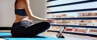 Woman meditating at home in terrace, panoramic image