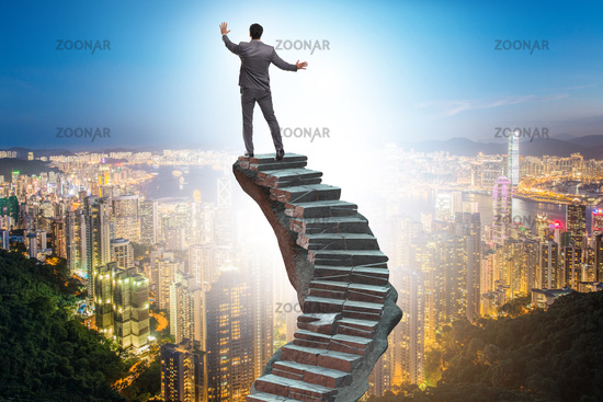 Concept of career ladder with businessman