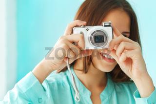 Portrait of a beautiful cute teen girl with digital photo camera