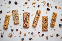 Homemade gluten free granola bars with mixed nuts, seeds, dried fruits