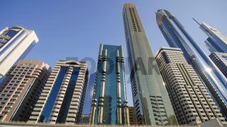 Tall and modern skyscrapers of Dubai on a sunny day.