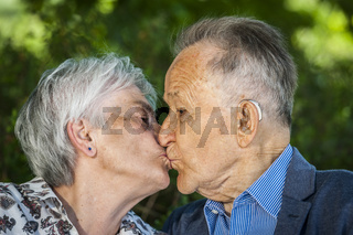 Seniors in love with a kiss