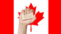 Caucasian male hand holding soap with words: Wash Your Hands, against a Canadian flag background