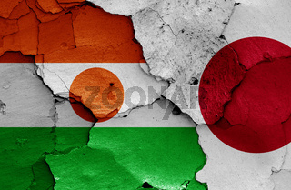 flags of Niger and Japan painted on cracked wall