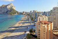 Sandy beach, Ifach natural park view. Calpe townscape, Costa Blanca, Spain