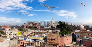 Agra poor buildings in front of Taj Mahal, India