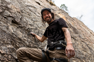 Portrait of a rock climber on a cliff