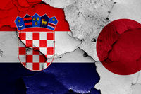 flags of Croatia and Japan painted on cracked wall
