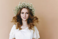 Beautiful blond woman with flowers wreath